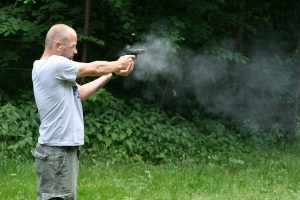 man-shooting-a-gun-1390372-m